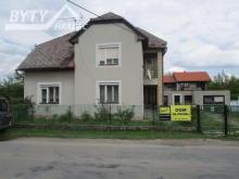 Prodej patrového RD s velkou zahradou a garáží v Jásenné